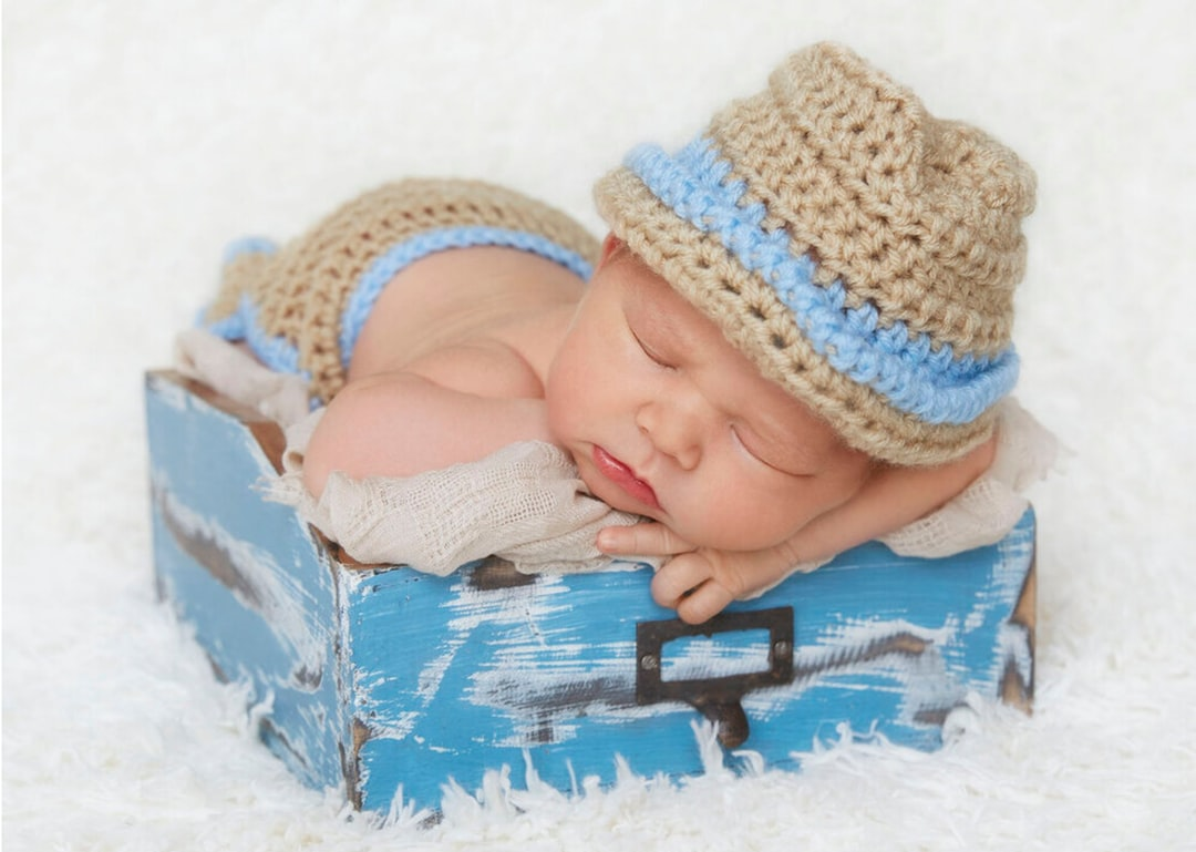A baby wearing a hat